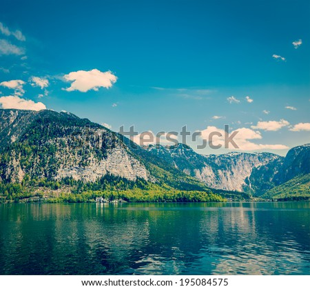 Vintage retro effect filtered hipster style travel image of castle at Hallstatter See mountain lake in Austria. Salzkammergut region, Austria - stock photo
