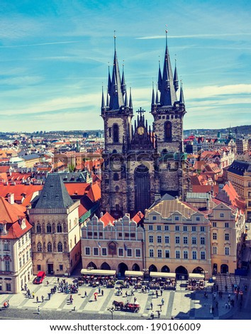 Vintage retro effect filtered hipster style travel image of Tyn Church (Tynsky Chram) on Old City Square from Town Hall. Prague, Czech Republic - stock photo