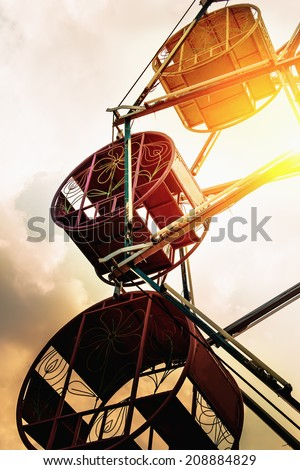 Vintage retro ferris wheel at sunset - stock photo