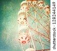 Vintage Retro Ferris Wheel on Blue Sky - stock photo