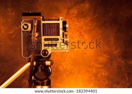 Vintage retro film camera on a tripod - stock photo