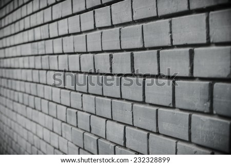 Vintage, retro gray brick wall with black amount /wallpaper