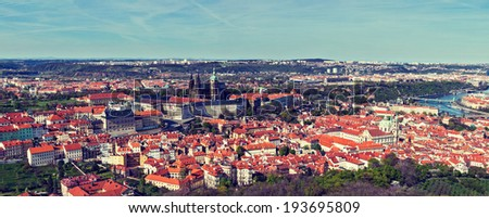 Vintage retro hipster style travel image of aerial panorama of Hradchany: the Saint Vitus (St. Vitt's) Cathedral and Prague Castle. Prague, Czech Republic - stock photo
