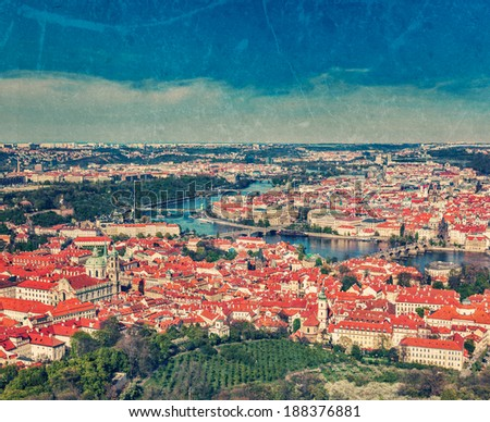 Vintage retro hipster style travel image of aerial view of Charles Bridge over Vltava river and Old city from Petrin hill Observation Tower with grunge texture overlaid. Prague, Czech Republic - stock photo