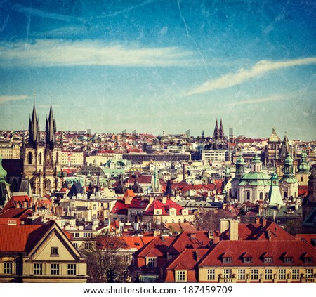 Vintage retro hipster style travel image of aerial view of Prague, Czech Republic with grunge texture overlaid - stock photo