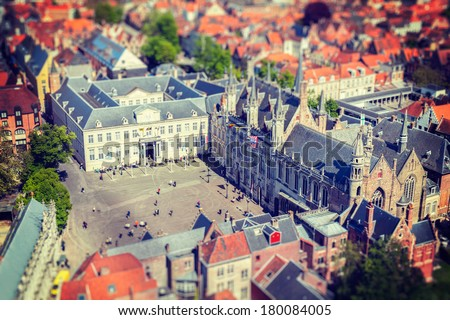 Vintage retro hipster style travel image of aerial view of the Burg square with the City Hall. Bruges (Brugge) , Belgium - stock photo