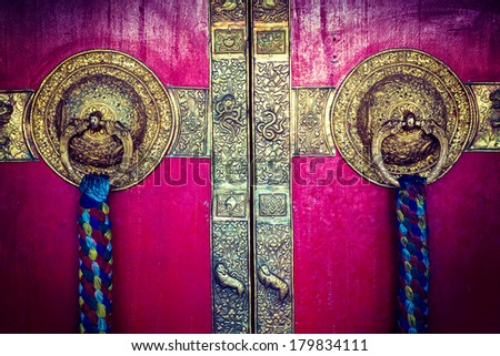 Vintage retro hipster style travel image of door handles on gates of Ki monastry. Spiti Valley, Himachal Pradesh, India - stock photo