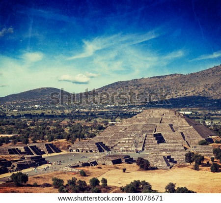 Vintage retro hipster style travel image of famous Mexico landmark tourist attraction - Pyramid of the Moon, view from the Pyramid of the Sun. Teotihuacan, Mexico with grunge texture overlaid - stock photo