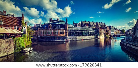 Vintage retro hipster style travel image of Ghent canal and medieval building panorama. Ghent, Belgium - stock photo