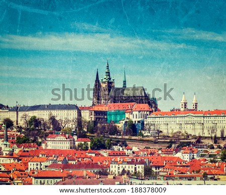 Vintage retro hipster style travel image of  Hradchany: the Saint Vitus (St. Vitt's) Cathedral and Prague Castle, Prague, Czech Republic with grunge texture overlaid - stock photo