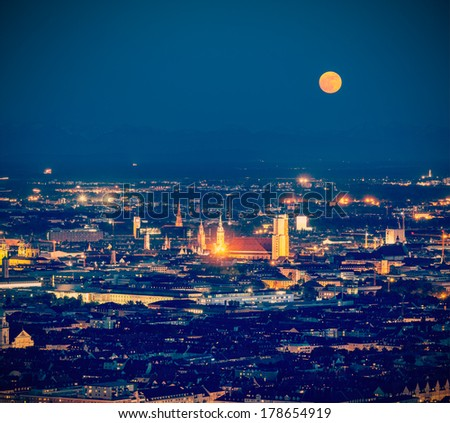 Vintage retro hipster style travel image of night aerial view of Munich from Olympiaturm (Olympic Tower). Munich, Bavaria, Germany - stock photo