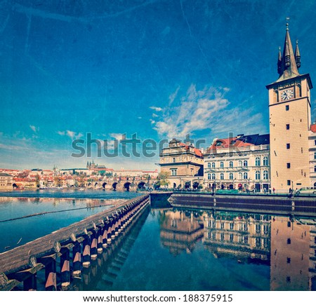 Vintage retro hipster style travel image of Prague Stare Mesto embankment view from Charles bridge with grunge texture overlaid. Prague, Czech Republic - stock photo