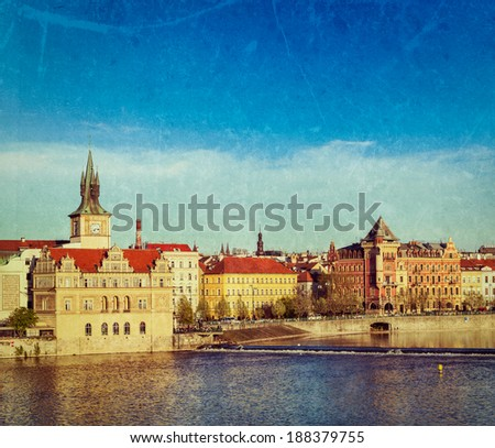 Vintage retro hipster style travel image of Prague Stare Mesto embankment view from Charles bridge on sunset with grunge texture overlaid. Prague, Czech Republic - stock photo