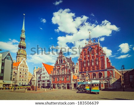 Vintage retro hipster style travel image of  Riga Town Hall Square, House of the Blackheads and St. Peter's Church, Riga, Latvia - stock photo