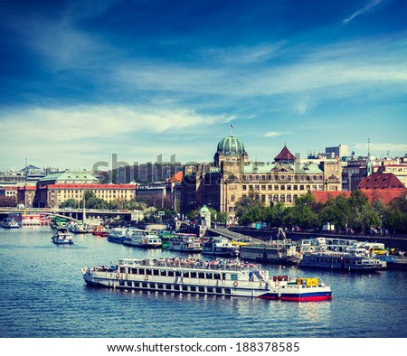 Vintage retro hipster style travel image of tourist boats on Vltava river in Prague, Czech Republic - stock photo