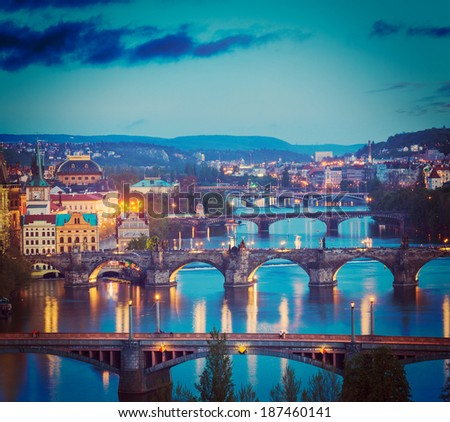 Vintage retro hipster style travel image of travel Prague concept background - elevated view of bridges over Vltava river from Letn���¡ Park. Prague, Czech Republic in twilight - stock photo