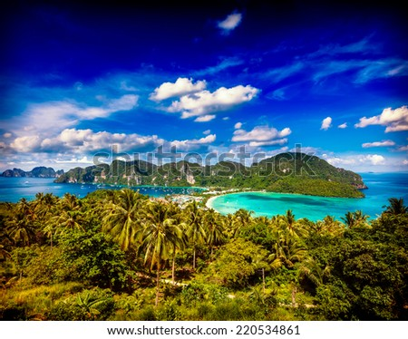 Vintage retro hipster style travel image of Travel vacation background - Tropical island with resorts - Phi-Phi island, Krabi Province, Thailand - stock photo