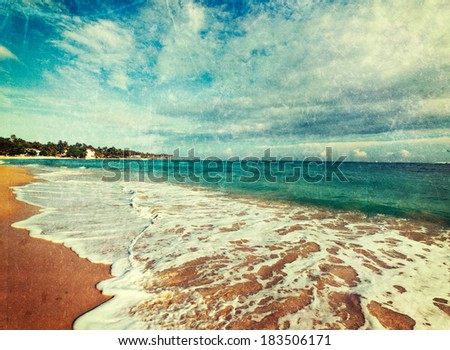 Vintage retro hipster style travel image of tropical paradise idyllic beach with grunge texture overlaid. Sri Lanka - stock photo