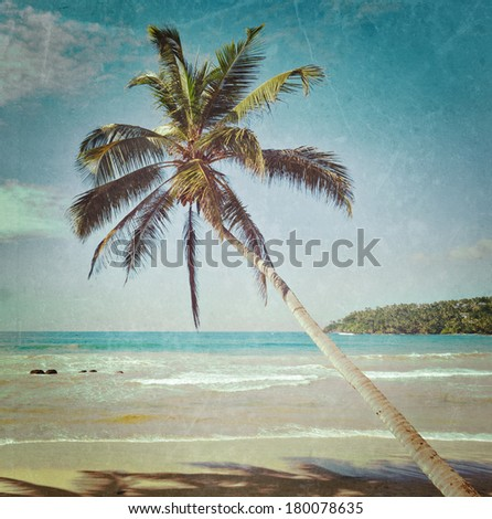 Vintage retro hipster style travel image of tropical paradise idyllic beach with palm with grunge texture overlaid. Sri Lanka - stock photo