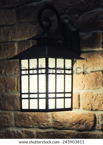 Vintage retro lamp on brick wall
