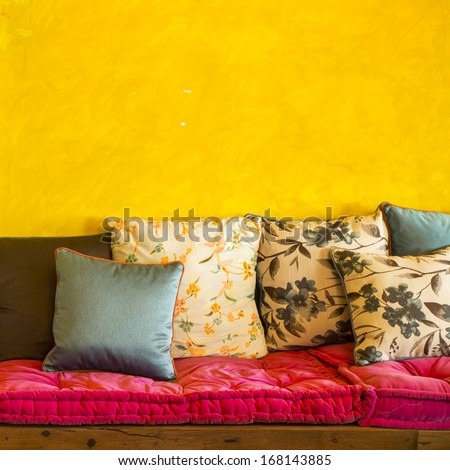 Vintage retro living room with pillows - stock photo