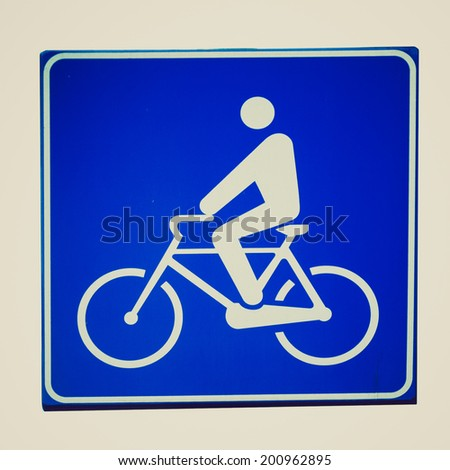 Vintage retro looking Bike lane traffic sign isolated on white