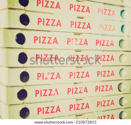 Vintage retro looking Corrugated cardboard boxes for take away pizza - stock photo