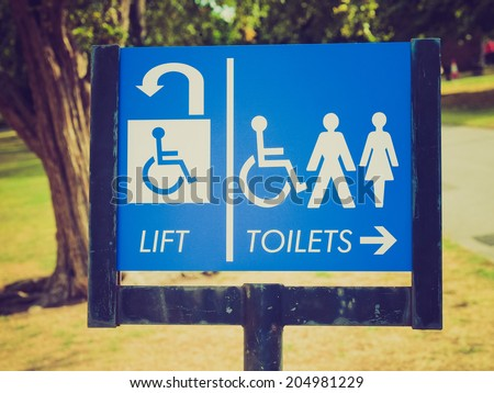 Vintage retro looking Disabled lift and toilets sign