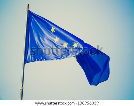 Vintage retro looking Flag of the European Union over blue sky