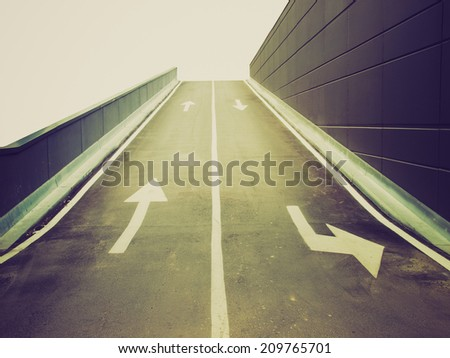 Vintage retro looking Garage access ramp (with UK left side drive) - stock photo