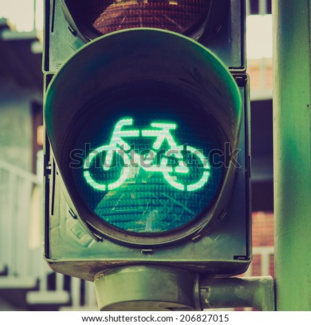 Vintage retro looking Green light for bycicle lane on a traffic light - stock photo
