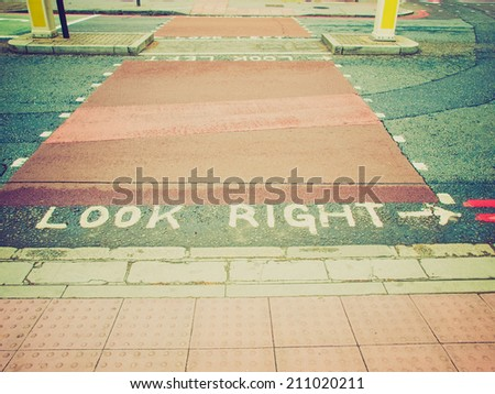 Vintage retro looking Look Right sign in a London street - stock photo