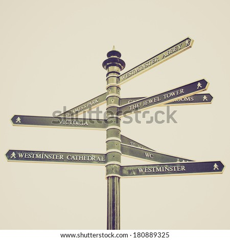 Vintage retro looking Traffic direction arrows sign, London, UK - isolated over white - stock photo