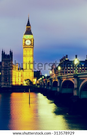 VINTAGE/RETRO PHOTO FILTER EFFECT: Elizabeth Tower, Big Ben, Houses of Westminster and Westminster Bridge from the South Bank of the River Thames at Dusk, London, England UK