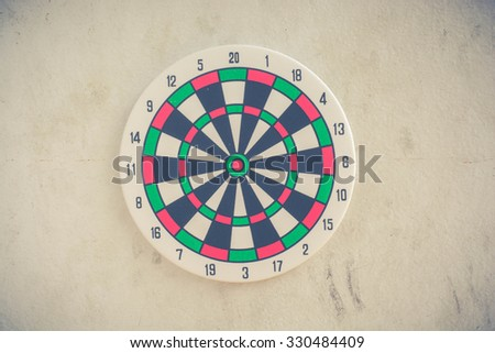 Vintage retro picture style - Dart is an opportunity and Dartboard is the target and goal. - stock photo