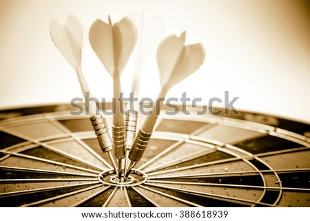 Vintage retro picture style - Dart is an opportunity and Dartboard is the target and goal. So both of that represent a challenge. Bullseye and Dart. opportunity, risk management, business concept. - stock photo