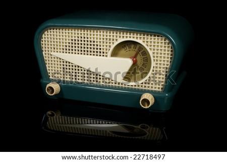 Vintage retro radio isolated on black background - stock photo