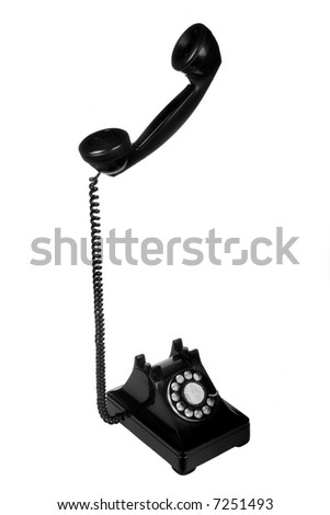 Vintage retro rotary telephone on white background
