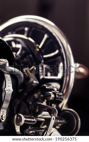 Vintage retro sewing machine on a black background - stock photo