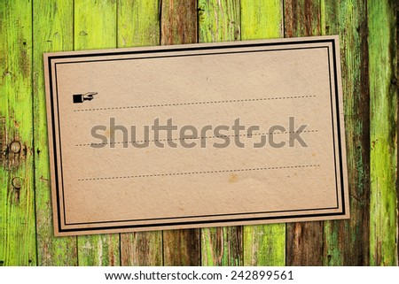 Vintage retro Sticker paper Label Tag as Copy Space on Wooden Background - stock photo