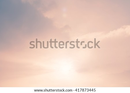 Vintage retro style blur nature background soft cloudy sky with bright light ray illumination glowing sunlight cloud sunset: Blurry natural sun flare backdrop pastel pink blue pantone color tone - stock photo