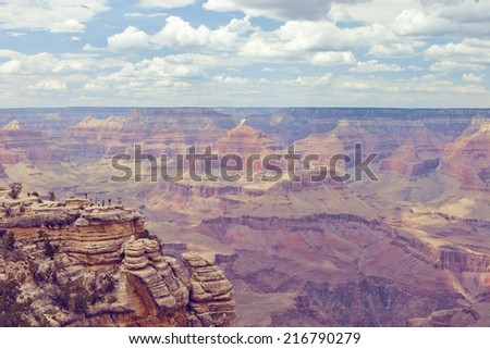 Vintage retro stylized photo of Grand canyon with blue sky and clouds in the background - stock photo