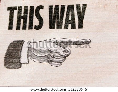Vintage retro This way sign hand pointing steampunk - stock photo