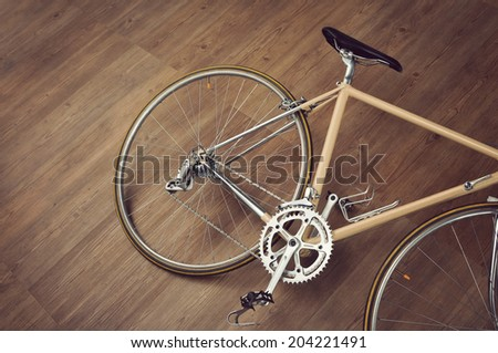 Vintage road bicycle on wooden floor - stock photo