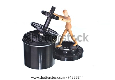 Vintage Roll Film Developing Tank with Art Doll - stock photo