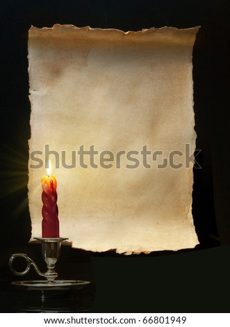 Vintage roll lit a candle - stock photo