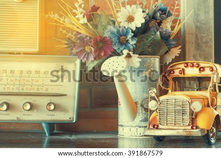vintage room, retro interior car model on top table. public location. old film processed for vintage photo style - stock photo