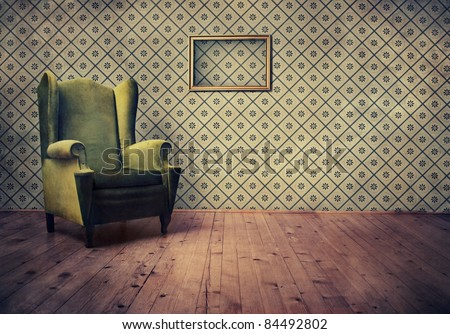 Vintage room with wallpaper and old fashioned armchair - stock photo