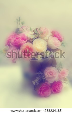 Vintage roses in blurry background