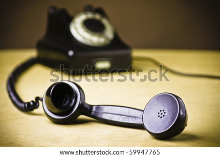 Vintage Rotary Dial Telephone. Soft focus with focus on handset. - stock photo